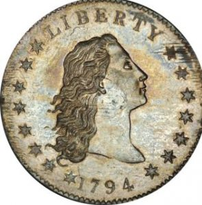 flowing hair face 1 295x300 - A Flowing Hair Silver Dollar, the first silver dollar struck by the United States Mint, is pictured in this handout photo