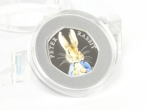 st 2016 peter rabbit silver proof 50p coin reverse 300x225 - The 2016 Peter Rabbit Silver Proof Coloured 50p Coin