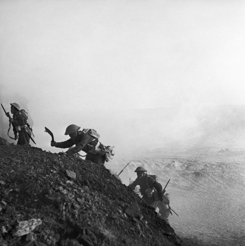 Ghurkas advance through a smokescreen up a steep slope in Tunisia 16 March 1943. NA1096 - The coins struck with WWII bullets collected from the battlefield…