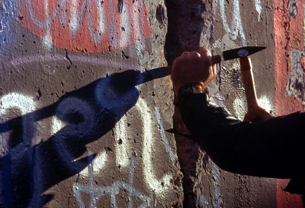 Chipping off a piece of the Berlin Wall 1024x699 - The Great Escape from East Berlin