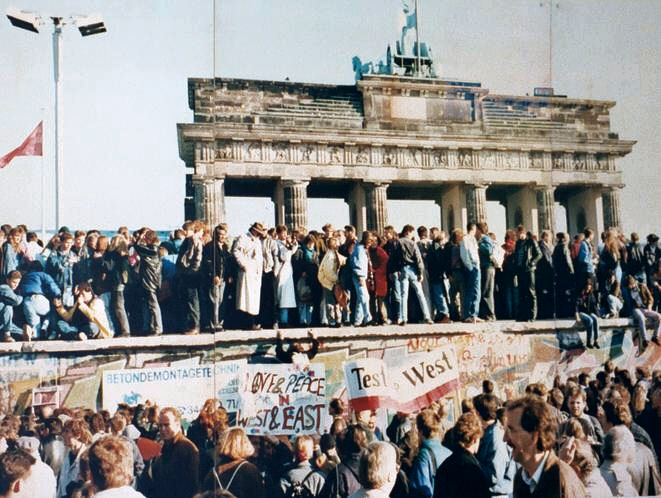 West and East Germans at the Brandenburg Gate in 1989 - The Great Escape from East Berlin